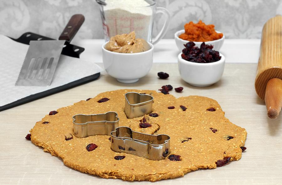 Table set up for baking peanut butter, oat dog cookies. © bigstockphoto.com / Rojoimages